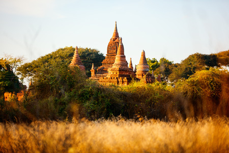 Stunning landscape view of historic buddhist pagodas in Bagan Archeological area in Myanmar 스톡 콘텐츠