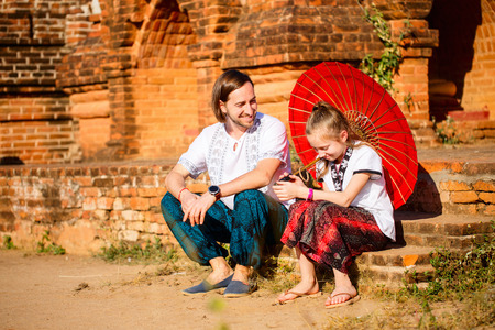 Family of father and daughter visiting ancient temples in Bagan Archeological area in Myanmar 스톡 콘텐츠 - 117618472