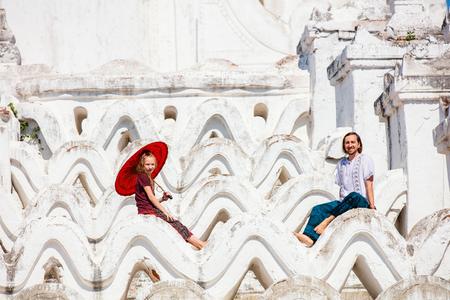 Family of father and daughter enjoying visit to beautiful white Hsinbyume pagoda in Mingun Myanmar Banco de Imagens