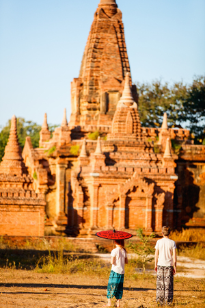 Kids brother and sister visiting ancient temples in Bagan Archeological area in Myanmar