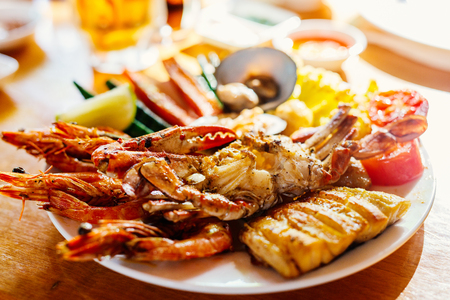 Close up of delicious grilled vegetables and seafood