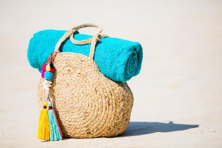 Straw bag close up on tropical white sand beach