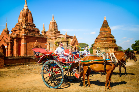 Kids brother and sister visiting ancient temples with horse cart in Bagan Archeological area in Myanmar Stock Photo