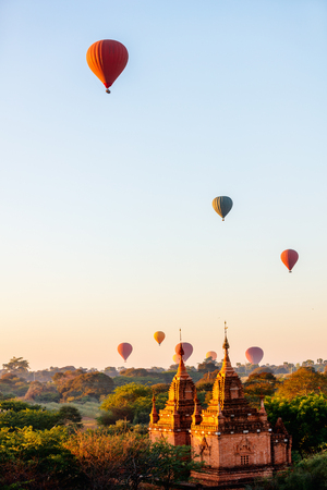 Stunning landscape view of hot air balloons fly over thousands of ancient pagodas at morning in Bagan Myanmar Banco de Imagens