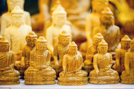 Wooden Buddha souvenirs at market in Myanmar