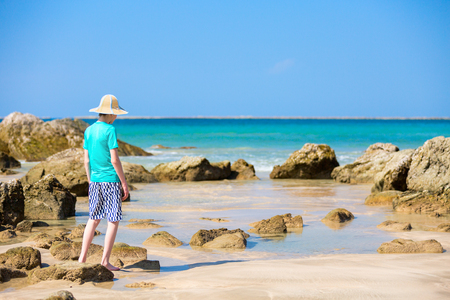 Teenage boy at beach during summer vacation in Myanmar Stock Photo