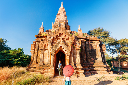 Family of mother and daughter visiting ancient temple in Bagan Archeological area in Myanmar