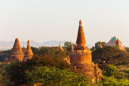 Stunning landscape view of historic buddhist pagodas in Bagan Archeological area in Myanmar 스톡 콘텐츠 - 120141302