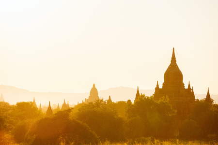 Scenic sunset with thousands of historic buddhist temples and stupas in Bagan Archeological area in Myanmar 스톡 콘텐츠 - 120141077