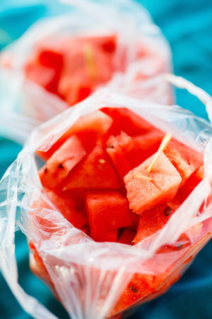 Fresh watermelon pieces in a plastic bag popular snack at beach in south-east asia Фото со стока