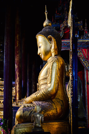Buddha statue in pagoda on Inle Lake in Myanmar