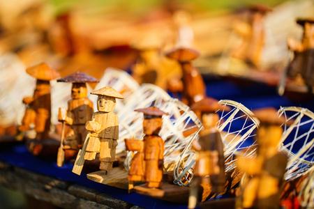 Wooden fishermen souvenirs at market on Inle lake in Myanmar