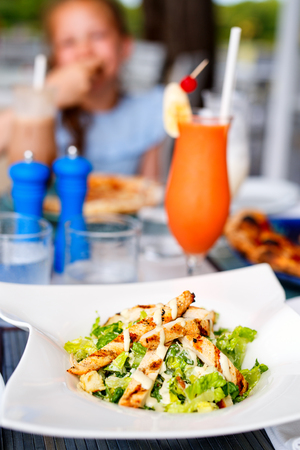 Delicious Caesar salad with grilled chicken served for lunch or dinner
