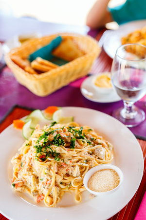 Delicious fish, shrimp and scallop pasta served for lunch or dinner