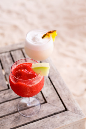 Exotic cocktails on tropical beach at luxury vacation resort