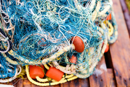 Close up of blue and green fishing net