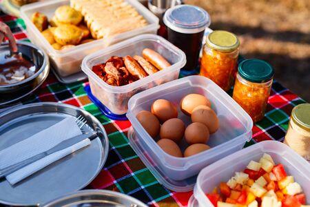 Traditional safari picnic bush breakfast with eggs, bacon and coffee