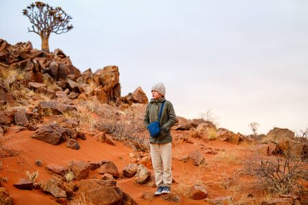 Young girl outdoor at Namib desert on cold winter evening 写真素材