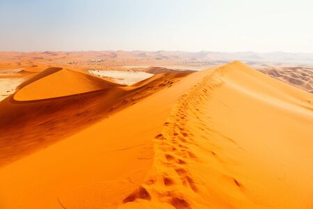Breathtaking view of red sand dunes and white clay pan of Deadvlei Namibia