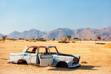 Abandoned old car near a service station at Solitaire in Namibia Stok Fotoğraf