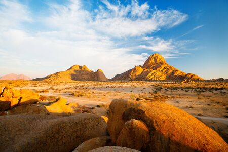 Beautiful sunrise over Spitzkoppe area with picturesque stone arches and unique rock formations in Damaraland Namibia