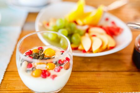 Delicious healthy breakfast youghurt with berries and fruits 写真素材