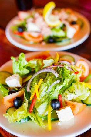 Delicious fresh Greek salad served for lunch at restaurant 写真素材