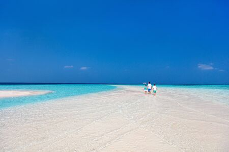 Father and kids enjoying summer beach vacation on tropical island 写真素材