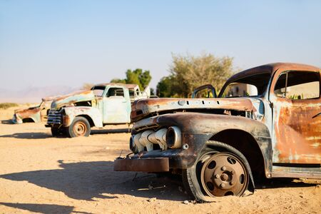Abandoned old cars near a service station at Solitaire in Namibia 写真素材