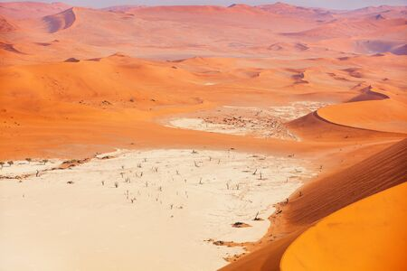 Breathtaking view of red sand dunes of Deadvlei in Namibia
