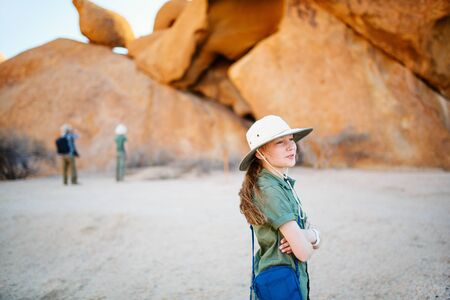Portrait of young girl hiking in Spitzkoppe with unique rock formations in Damaraland Namibia