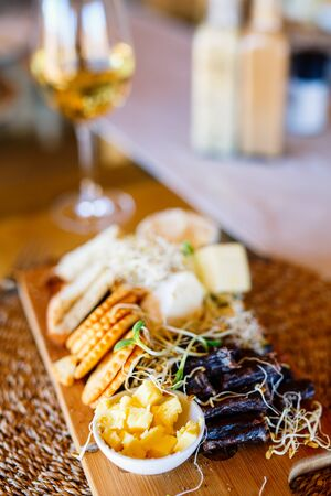 Appetizers platter with cheese and cold meat served in a restaurant 写真素材