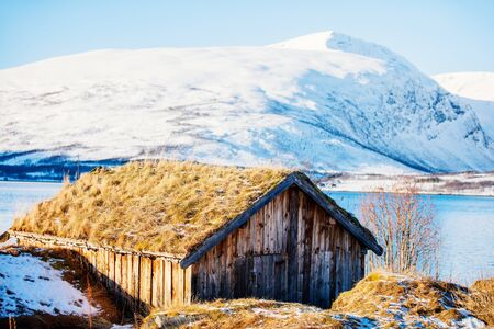 Traditional old wooden hut in Northern Norway Stock Photo