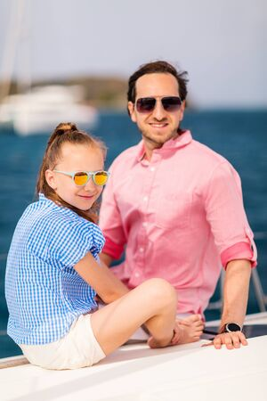 Father and daughter on board of sailing yacht having summer travel adventure Archivio Fotografico