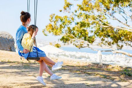 Happy mother and her adorable little daughter outdoors Stockfoto