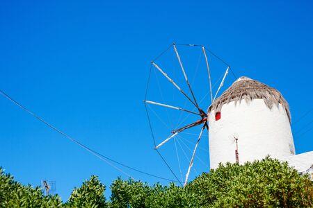 Old greek windmill in traditional village on Mykonos Island, Greece, Europe