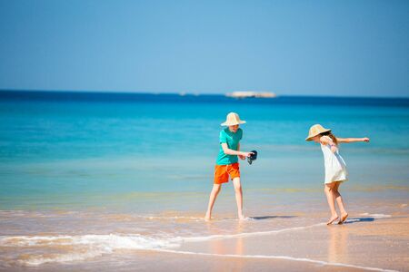 Kids having fun at beach during  summer vacation playing together