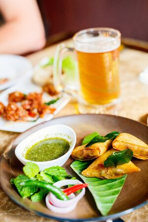 Asian food samosas with dipping sauces served for lunch Stockfoto