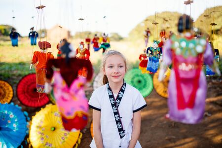 Young girl with traditional burmese string puppets in Myanmar Stockfoto