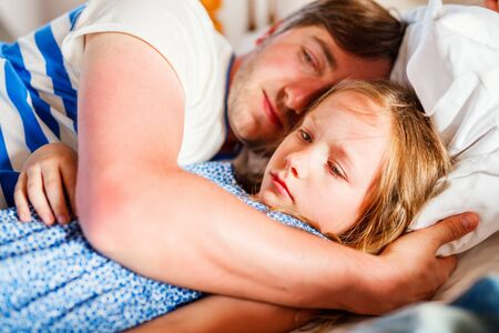 Happy father and his adorable little daughter together resting