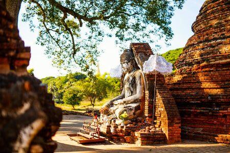 Ancient Yadana Hsemee Pagoda and Buddha statue in Inwa Myanmar