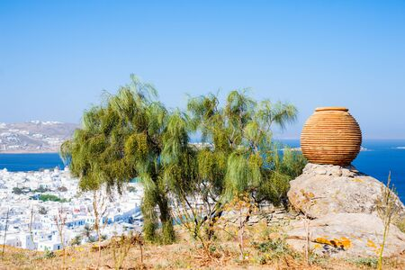 Ceramic pot overlooking traditional greek village with white houses on Mykonos Island, Greece, Europe
