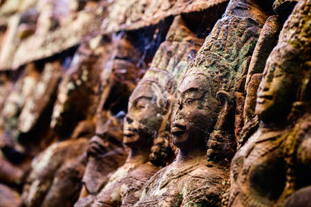 Bas reliefs in Terrace of the Leper King in Angkor Archaeological area in Cambodia