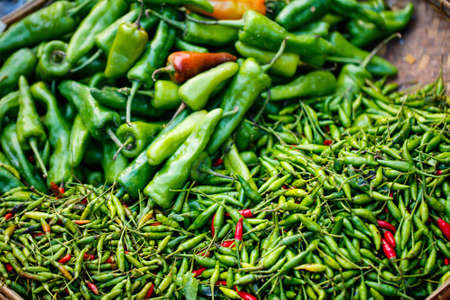 Green hot chili peppers at market