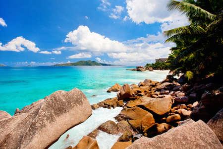 Beautiful little secluded beach at tropical La Digue island on Seychelles Zdjęcie Seryjne