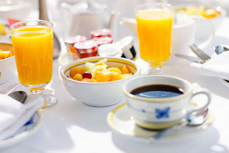 Fresh coffee, orange juice and fruit salad served for breakfast