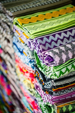 Colorful textiles and fabrics at traditional market in Myanmar