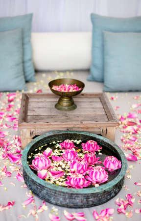 Romantic beach cabana decorated with lotus flowers