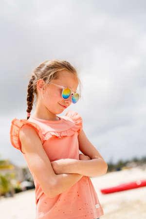 Adorable little girl at beach during summer vacation having fun Zdjęcie Seryjne