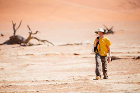 Teenage boy walking in desert in Namibia Zdjęcie Seryjne